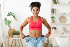 Weight loss showing old pair jeans   Featured image for what is a tummy tuck.