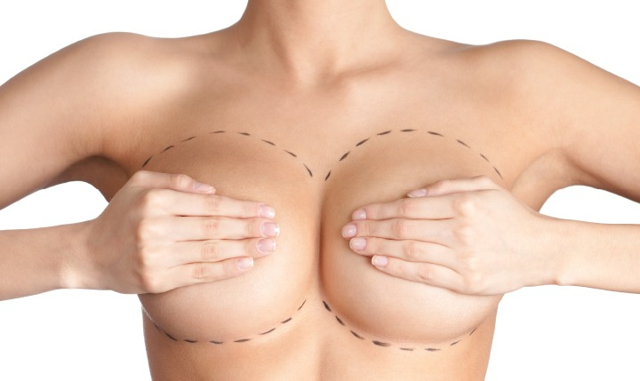 Woman Covering Her Breasts with Her Hands