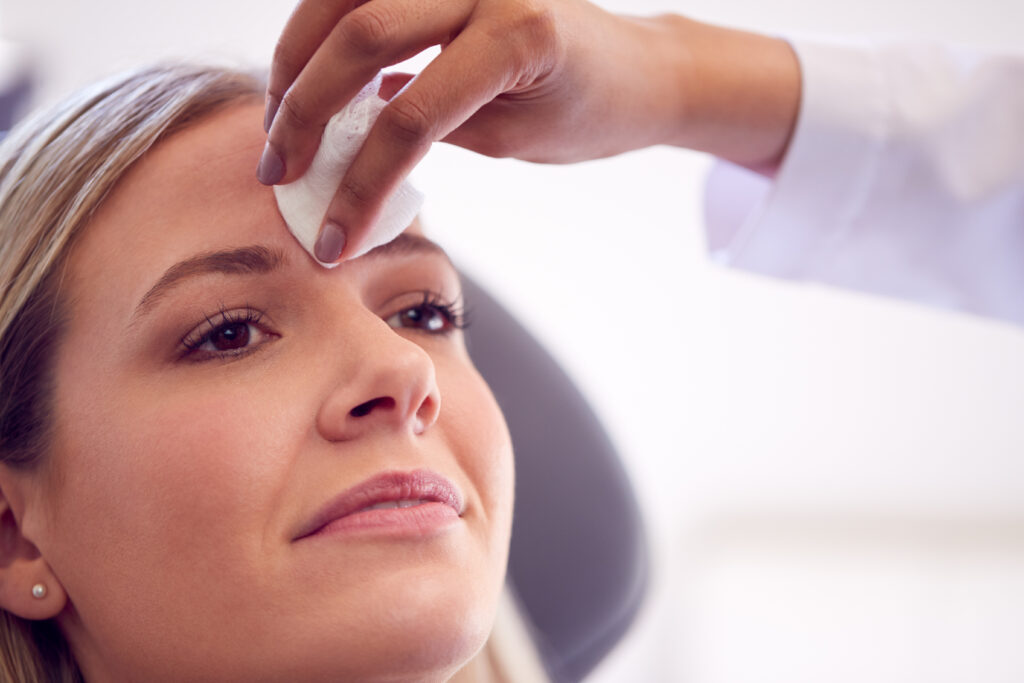 Woman receiving dermal fillers| Featured image for Rejuvenating Your Skin With Dermal Fillers | Blog