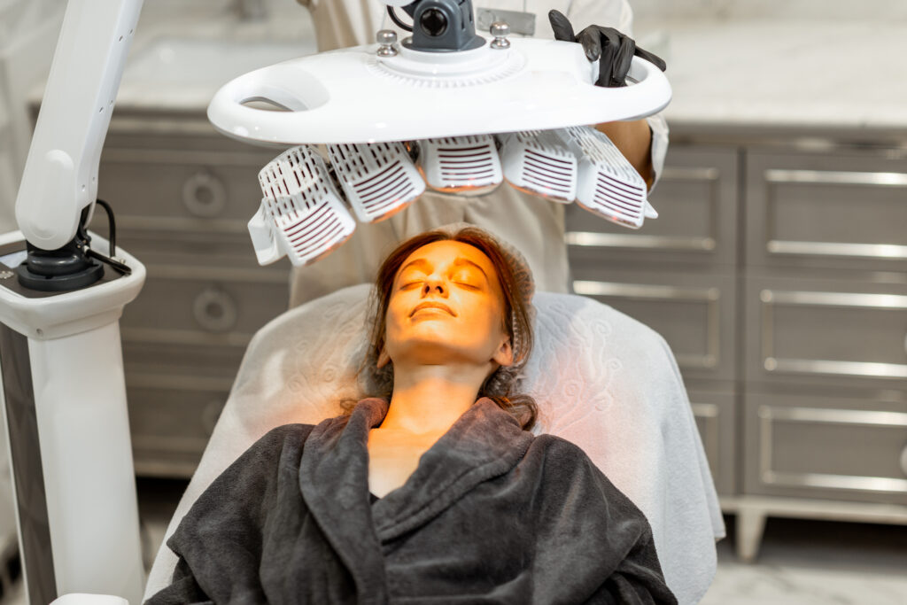 Woman receiving light therapy | Featured Image for Infrared Light Therapy Post Cosmetic Surgery | Blog